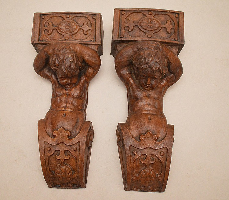 Pair composition decorative figural columns, 31