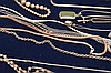 26 assorted silver necklaces