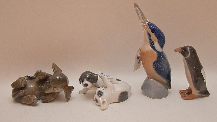 4 Royal Copenhagen animal figures, 2 dogs, 1 penguin and 1 bird, 1 5/8