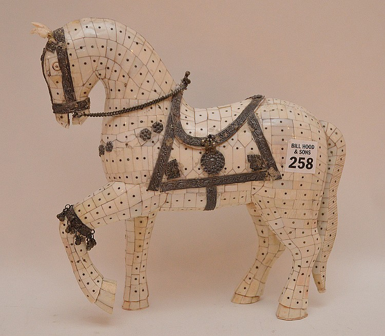 Bone Tiled Horse with silver decoration. H. 9 1/2