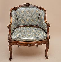 French carved walnut bergere with caned seat, blue damask upholstery, 34