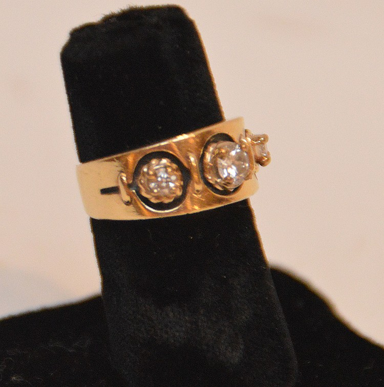 ladies 14kt yellow gold ring with 3 diamonds. Center diamond i-k appr. .30 pts, 2 side diamonds .18cts.
