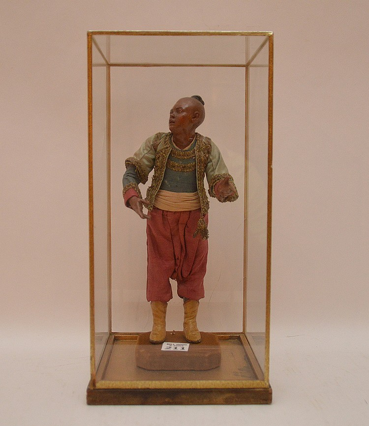 Antique Crèche Figure with glass case. The case has cracks in the glass. Ht. 10 3/4