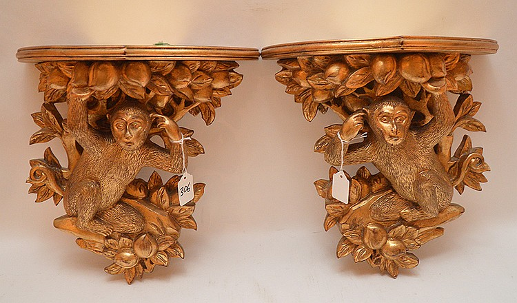 Pair Composition Gilt Figural Money Brackets.  14