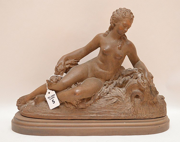 Antique French Terra Cotta Sculpture of a reclining nude maiden with a wood base.  Ht. 11
