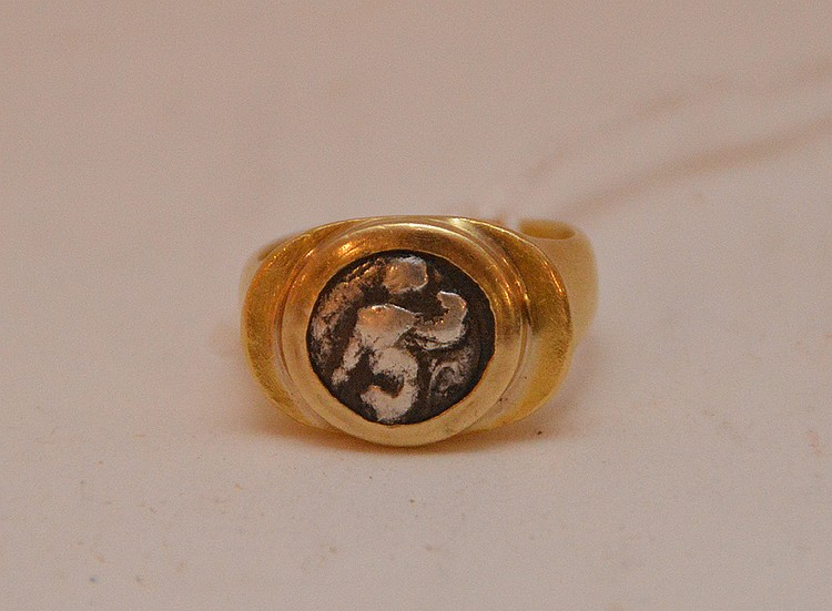 14K Yellow Gold Ring with old solver coin center.  16.5 grams total weight.