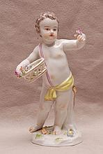 Meissen figure of boy with flower basket, 5 5/8