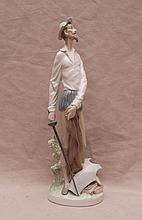 Lladro gentleman with breast plate holding sword,