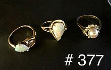 Three 14kt yellow gold rings, two rings with opals, one ring with pearl and diamonds, overall wt. 11 grams