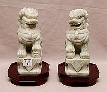 Pair Chinese carved hard stone foo dogs, 8