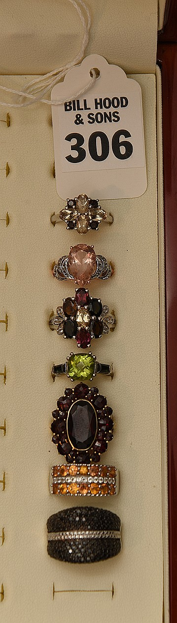 Lot 7 Assorted Rings Consisting of: 1 Citrine and Smokey Quartz on sterling, 1 yellow sapphire on sterling, 1 quartz and brown sapphires on sterling, 1 pink sapphire and 10k yellow gold, obsidian on sterling, tourmaline on sterling, garnet on 10k