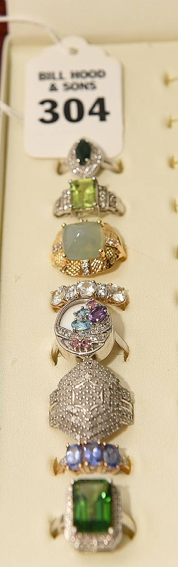 Lot 8 Assorted Rings comprising of: 1 Tourmaline and sterling, Sapphire and 10k yellow gold, Sterling & marcasite. Topaz, amethyst, zircon and sterling, White Sapphire & 10k yellow gold, Calcedony with 10K gold plated yellow gold, tourmaline &