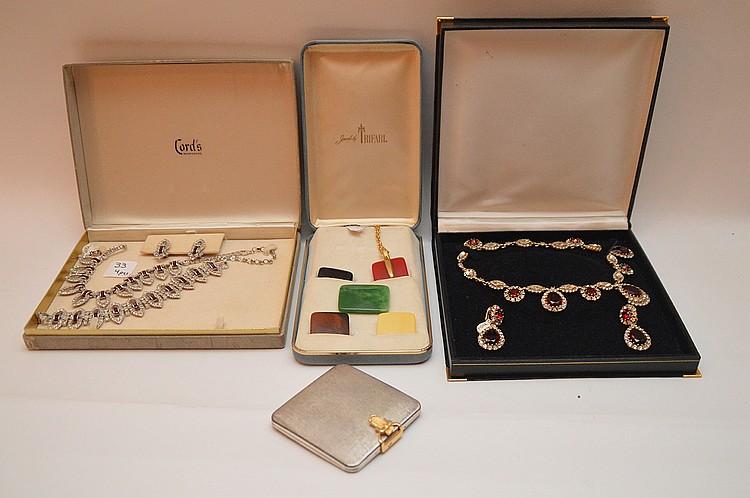 Lot 4 Pieces: 1 Signed Trifari 5 Color Clip Set, 1 Art Deco Style Necklace & Earrings, 1 Volupte Deco Buckle Form Compact 3 1/4