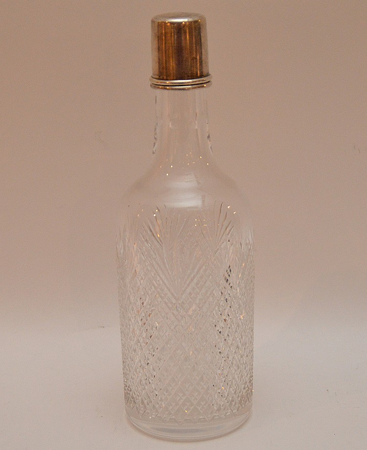 Cut glass whiskey bottle with sterling top, 10 3/8