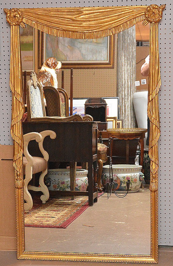 Gilded drape and swag motif mirror, 56