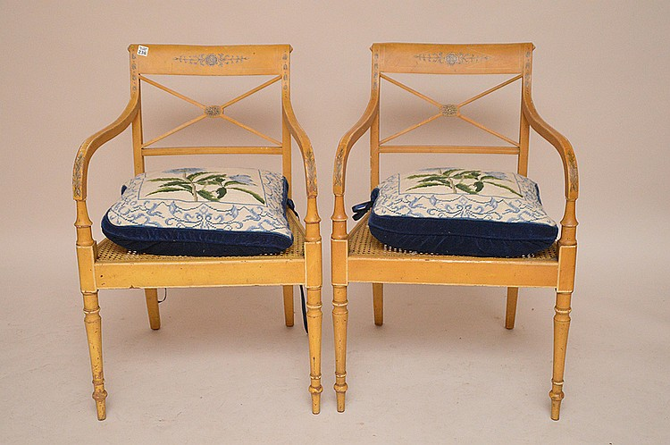 Pair mustard color painted Adams style arm chairs with caned seats