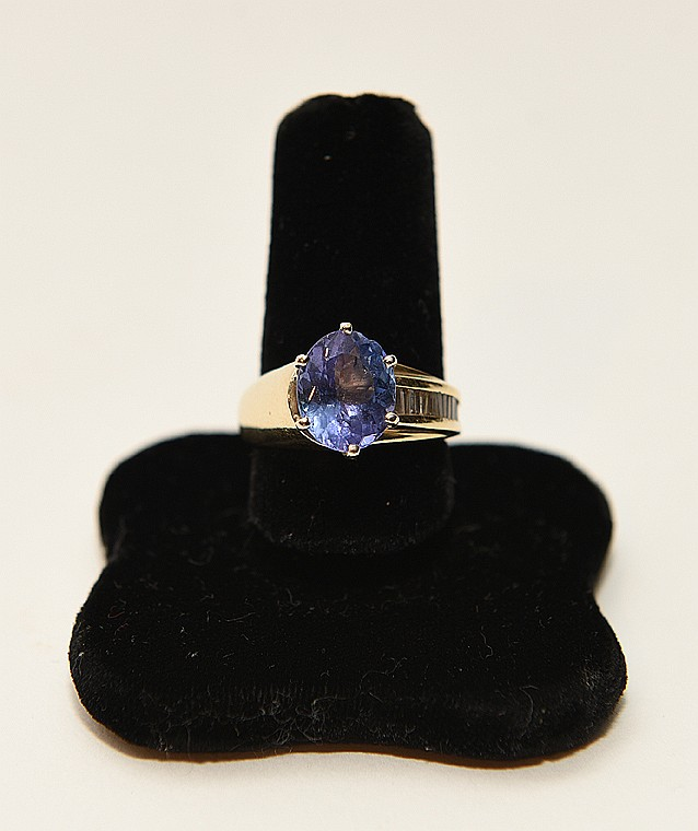 Ladies 14kt yellow gold tanzanite and diamond ring, tanzanite weighs 4ct and the straight baguettes weigh 1 ct total weight