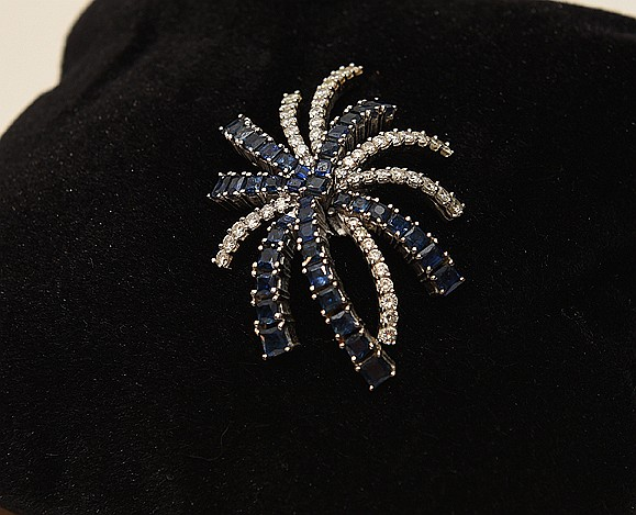Diamond and Sapphire Pendant starburst form. 18K white gold approx. 4 cts. Sapphire and approx 3cts. Diamonds.