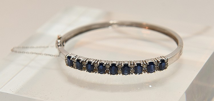 Lady's Bracelet 14k white gold approx 5cts. Sapphires and diamonds.