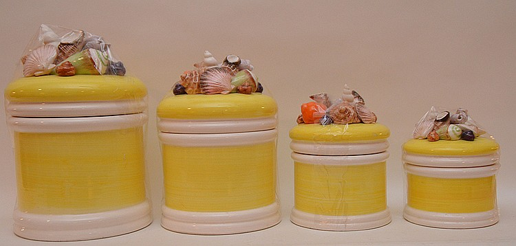 4pc. 1980's yellow canister set with shell motif on lids