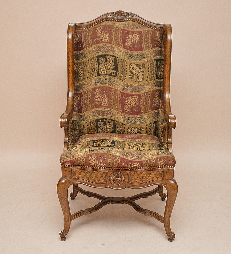 Oak wingback chair, paisley upholstery