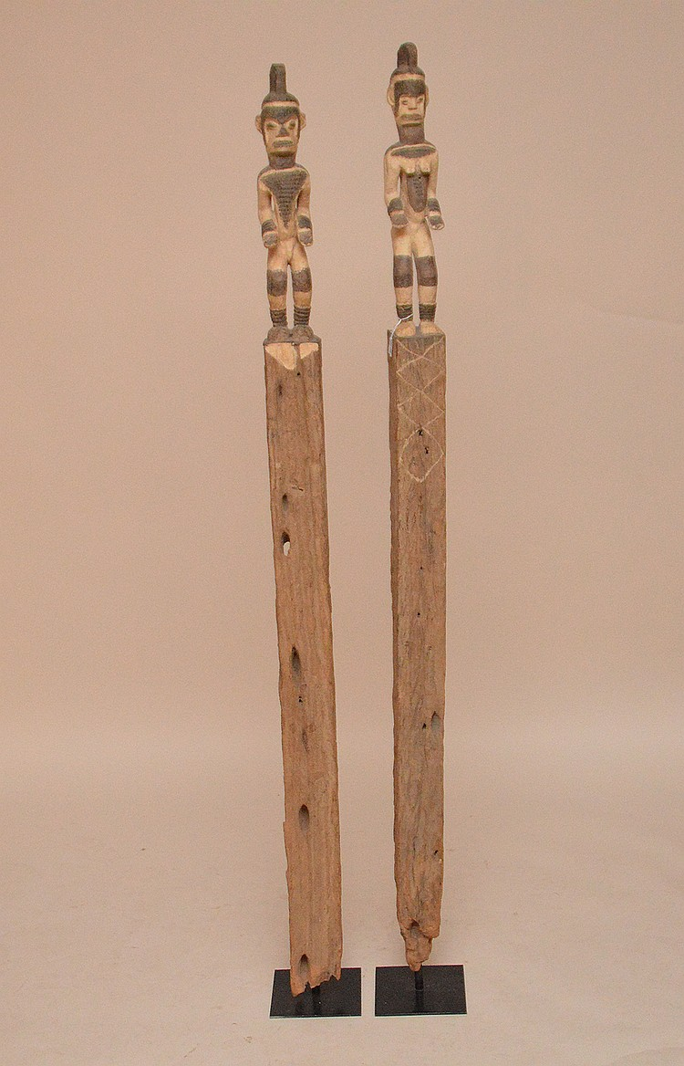 Pair faux wood tribal carvings, approx. 62