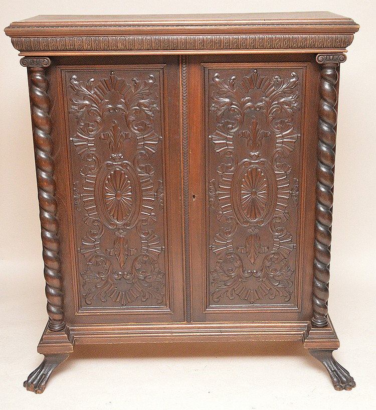 Circa 1900 heavily carved 2 door cabinet, 54