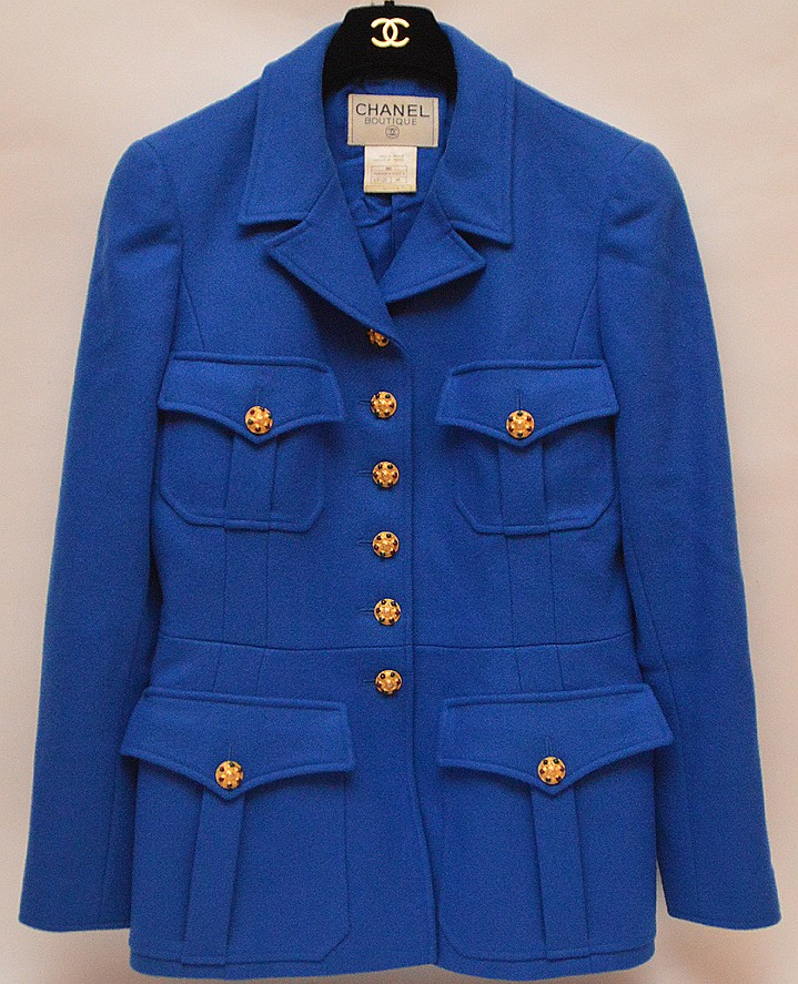 Fine 96A Chanel Royal Blue with Gripoix buttons wool jacket, made in France, original Chanel black velvet hanger with the gold logo. Comprised of 16 art work jeweled Gripoix buttons, light padding at shoulder, four pockets at front, fully lined with