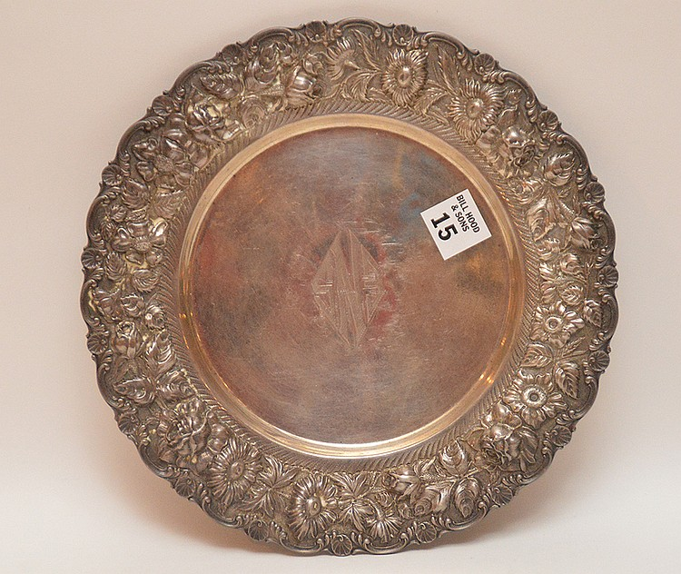 Stieff Sterling Plate with repousse floral rim.  Dia. 10