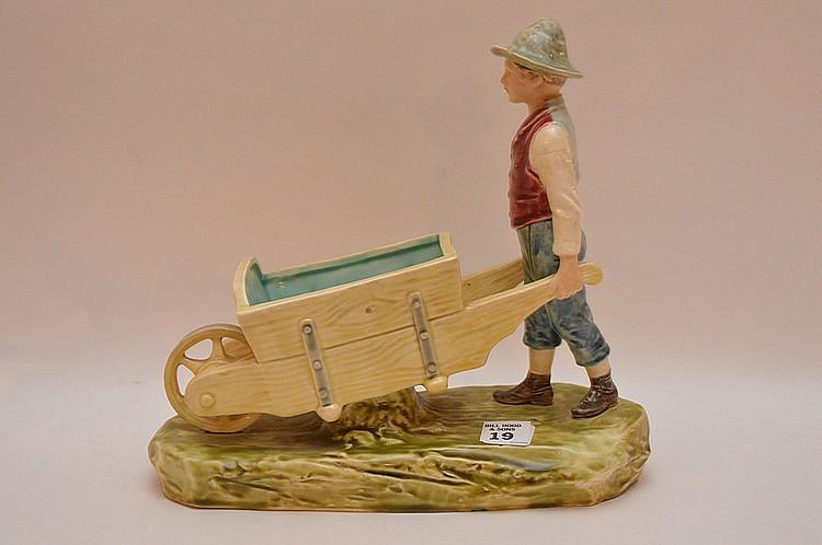 Majolica group, boy pushing wheel barrow, 10