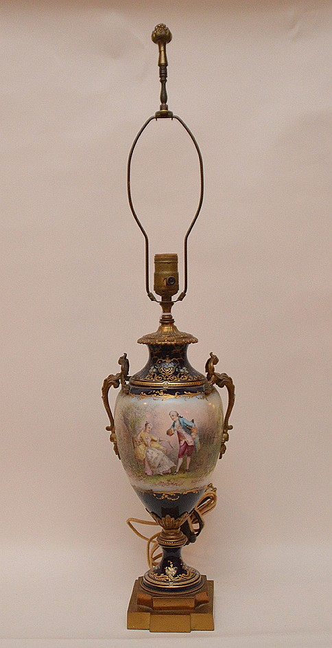 Sevres Porcelain & Bronze Lamp with hand painted romantic scene in a landscape. Signed A. Chapurs. Ht. 16 1/2