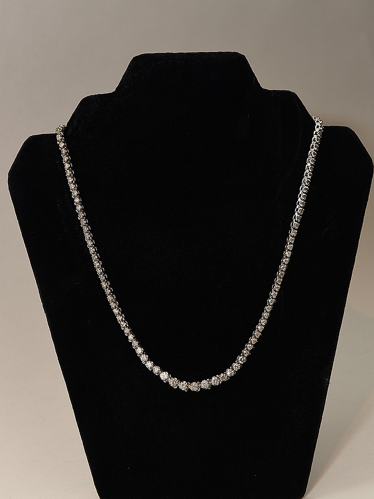 Ladies 14kt white gold diamond necklace containing round brilliant cut diamonds, Clarity SI 3, Color J, total Carat weight 8.00