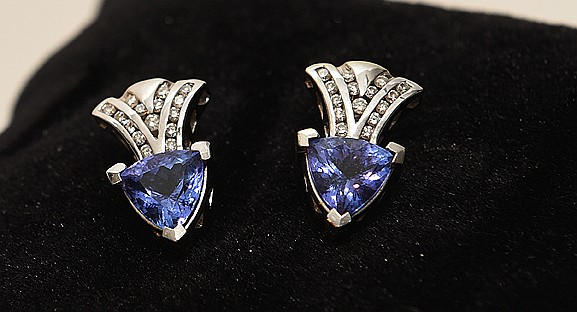 Pair 14kt white gold tanzanite and diamond earrings containing 2 trillion tanzanite weighing approx. 3 cts each, a total diamond weight approx. .75ct