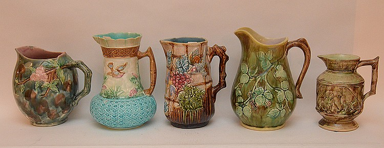 Lot 5 Majolica Pitchers. 1 Bolbous Body green, brown and pink decoration with raised flowers Ht. 8