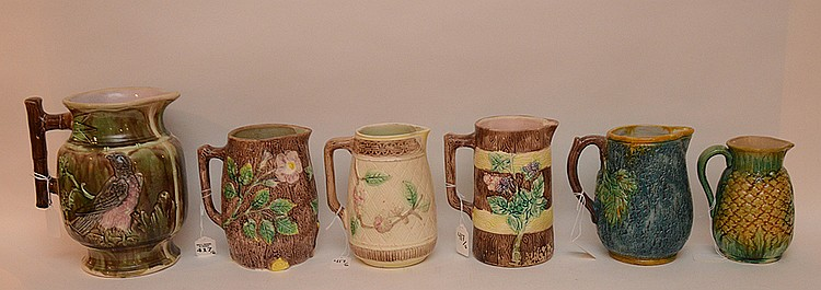 Lot 6 Majolica Pitchers. 1 Brown with foliate decoration on a tree trunk ground Ht. 7 1/4