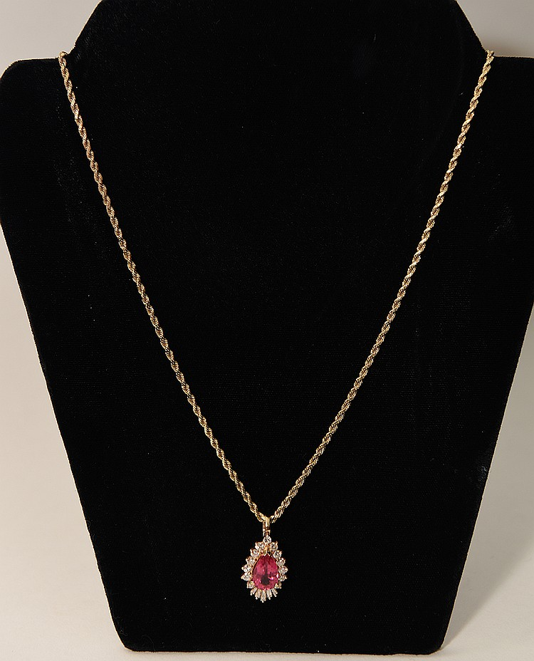 24. Pink Sapphire Pendant with 14K Yellow Gold Chain. Pink Sapphire is 3ct. with .8cts diamonds.