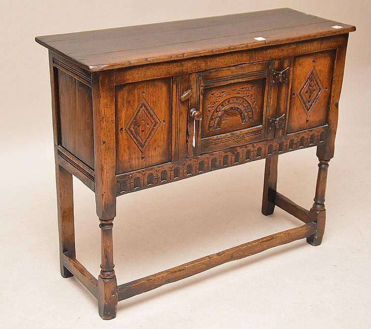 Carved oak cabinet with single carved center door, 30