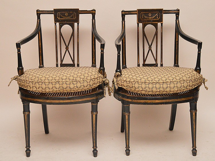 Pair painted black Adams style arm chairs with cushions on cane seats