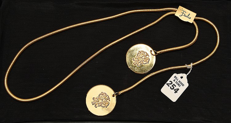 Emilio Pucci Gold Tone Chain Belt/Necklace . Comprised of Two Large Medallions with the Pucci Initials in relief. Bright gold tone colors in great & clean condition.