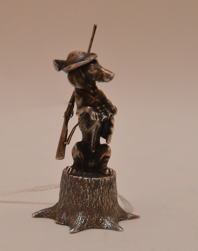 Russian Sterling Dog Figure with riffle, hat and bag.  Ht. 3