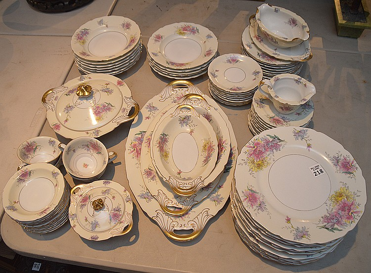 Black Knight partial dinner service, incl; 12 dinner plates, 9 salad plates, 10 bread and butter plates, 12 soups, 12 fruit plates, 9 saucers, 4 cups, 2 service platters, 2 bowls, 1 gravy, 1 tureen, creamer and sugar, 76 pieces
