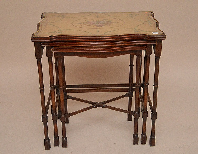 Nest of 3 bamboo style painted classical motif glass top tables, largest 25