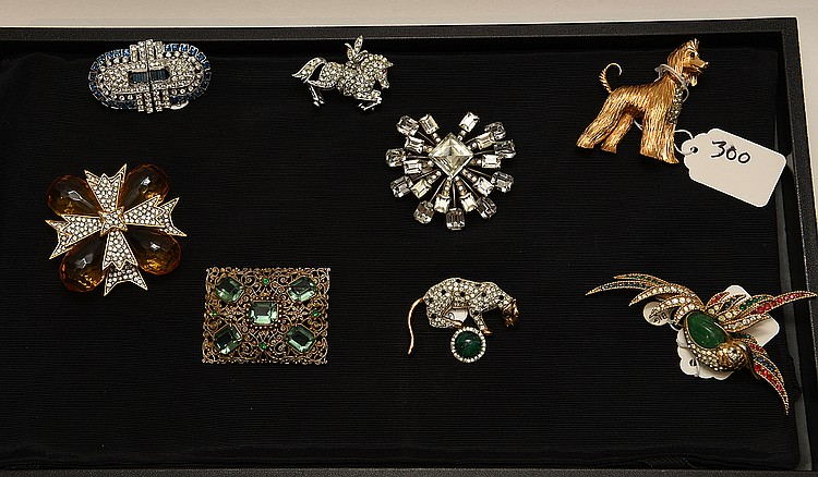 Lot of 8 pieces of costume jewelry, incl; (1) singed Lisner horse pin (1) bird pin multi color stones stamped Boucher (1) dog pin signed Jomez, 2 1/4