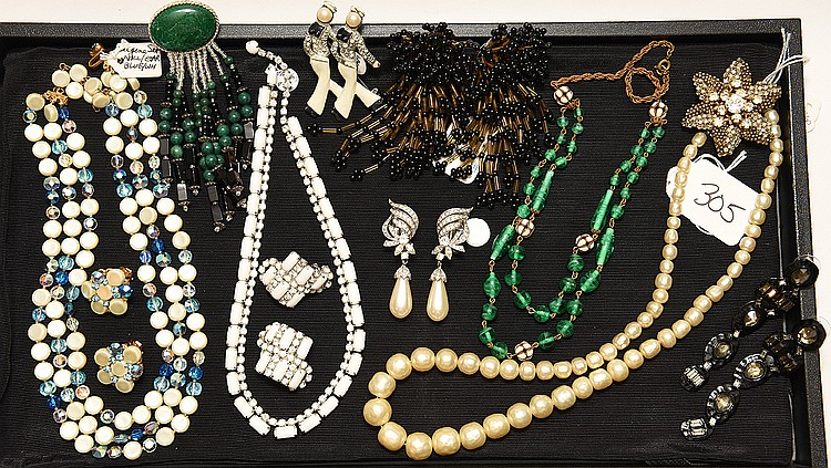 Lot of 9 pieces of costume jewelry, incl; (1) green glass 2 strand necklace (1) pin green stones (1) vintage triple strand necklace and matching earrings (1) pair drop faux pearl and rhinestone earrings (1) Kramer white and rhinestone necklace and