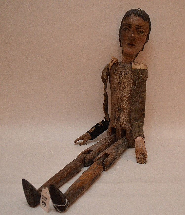 Rare Italian Hand Carved Puppet circa the 17th to the 18th Century. Upper body made of a small Helm tree trunk. All moving parts inserted by bended iron tiges. The remnant clothing strips are from the periods. Found in Venice, Italy in the 19th cent.