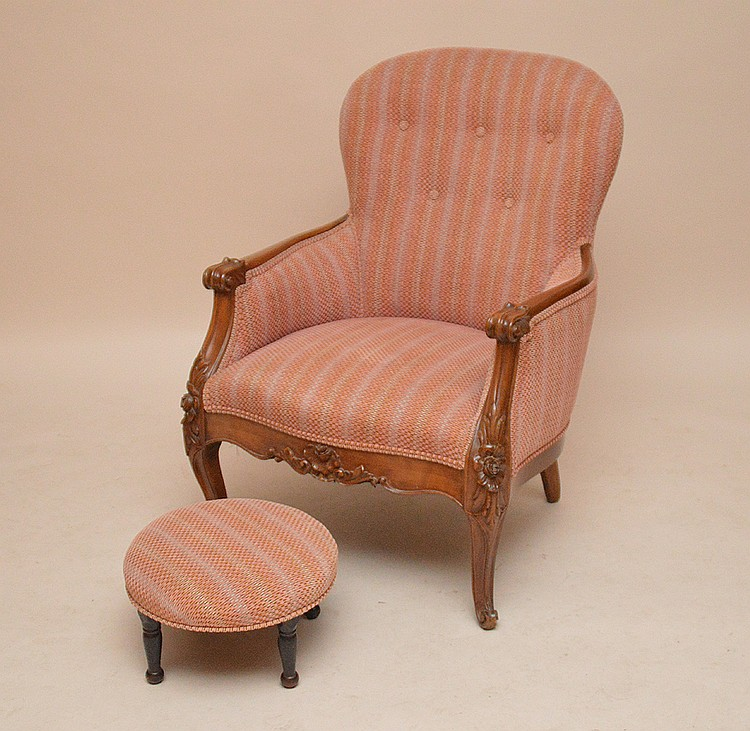 Carved wood arm chair with small round non matching frame stool