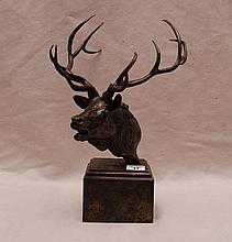 Bronze sculpture of elk on attached stand by