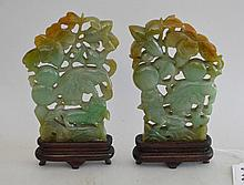Two Chinese Jade Carvings Depicting Foo Lions In Foliage mounted on custom wood bases. Condition: good with no noticeable damage. Ht. 4 1/2