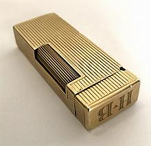 HUMPHREY BOGART'S 14KT GOLD DUNHILL LIGHTER - The Dunhill Rollalite lighter is monogrammed on the top with the initials