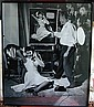 Signed Earl Moran Pin-up PhotoAutographed photo by America's premier pin-up artist EARL MORAN depicting Moran painting the original illustration with the live model posed sitting on the floor while talking on the telephone; signed with the original